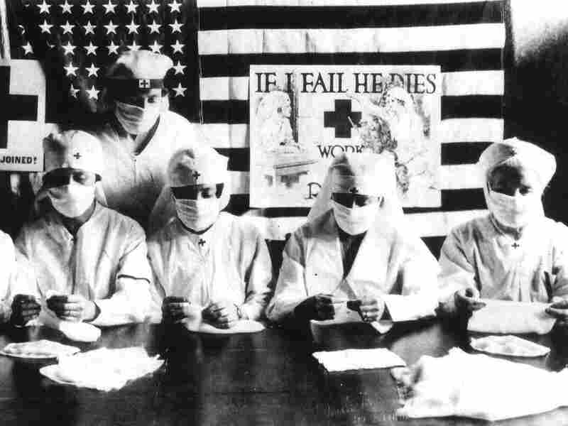 Red Cross nurses assembling cloth masks during the 1918 flu pandemic in the United States.