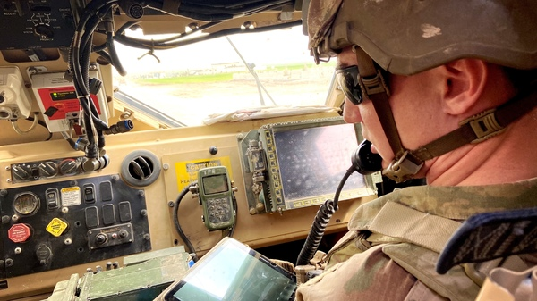 Capt. Alex Quataert points out the areas the soldiers are visiting on the map.