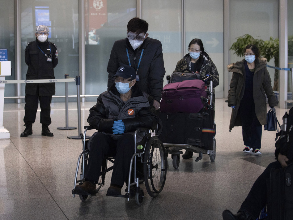 As the number of new cases dwindles in China but multiplies worldwide, the country has become more worried about importing cases. Earlier this month, travelers arriving from abroad left the Capital International Airport in Beijing. (Ng Han Guan/AP)