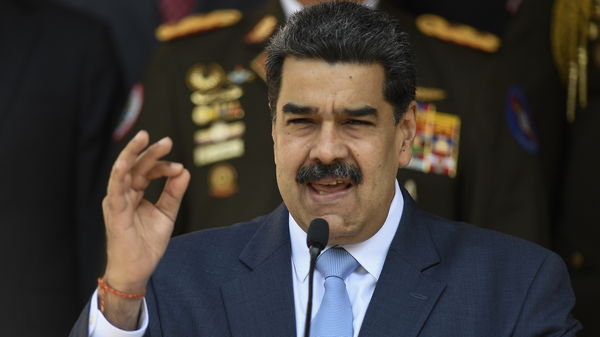 Venezuelan President Nicolas Maduro gives a press conference at the Miraflores Presidential Palace in Caracas, Venezuela, Thursday, March 12, 2020. He is the subject of a new federal indictment.