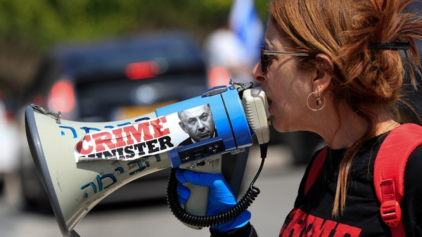 An anti-Netanyahu protester shouts slogans during a demonstration in front of the Knesset in Jerusalem on Wednesday.