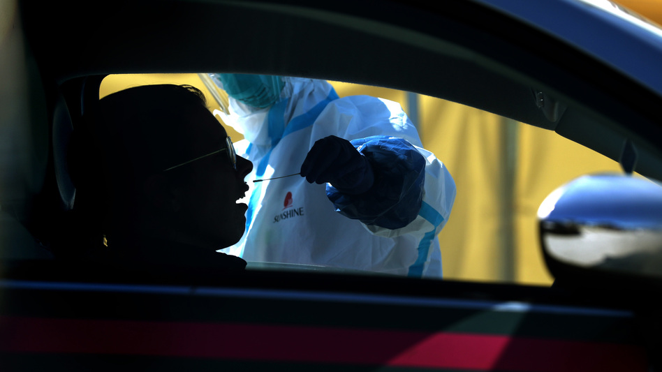 A motorist gets a drive-through coronavirus test Thursday in Daly City, Calif. The U.S. has surpassed China to have the world's largest number of coronavirus cases. (Justin Sullivan/Getty Images)
