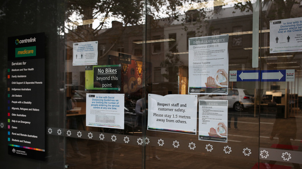 Signs on social distancing and COVID-19 outside an office in Sydney, earlier this week.
