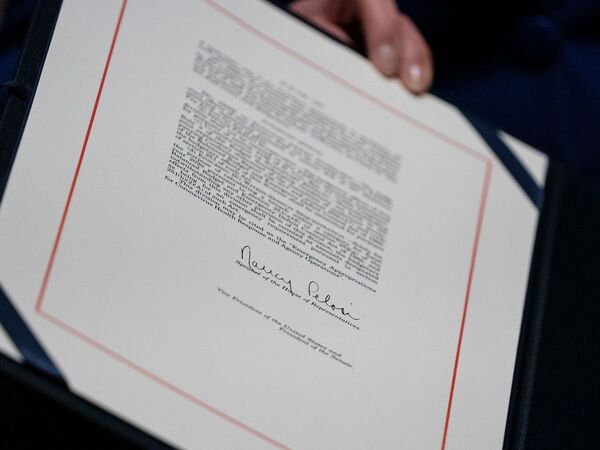 Speaker of the House Nancy Pelosi signed the relief bill earlier Friday after the House passed it.