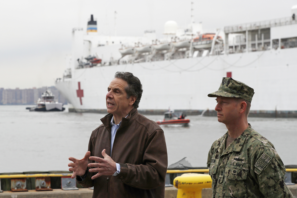New York Gov. Andrew Cuomo, left, speaks after the arrival of the USNS Comfort, a naval hospital ship with a 1,000 bed-capacity. (Kathy Willens/AP)