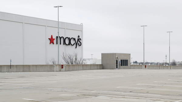An empty parking lot surrounds the Macy's at the Roosevelt Field Mall on March 20 in East Garden City, N.Y. The retail chain had previously announced plans to close about 125 stores over the next three years.
