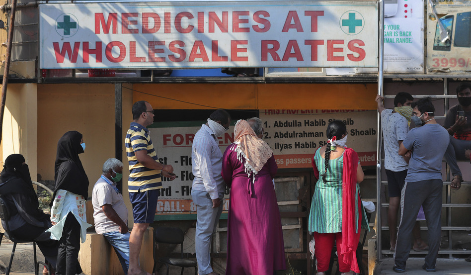"""Indians line up to buy medicines in Hyderabad on Sunday. Prime Minister Narendra Modi apologized for imposing a three-week national lockdown, but said it was """"needed to win"""" the battle against the coronavirus pandemic. India just surpassed 1,000 cases in recent days. (Mahesh Kumar A/AP)"""