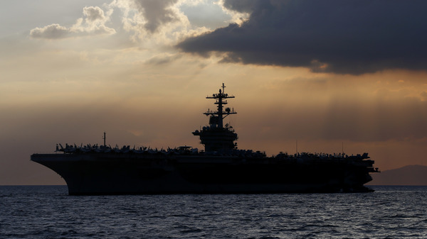 The U.S.S. Theodore Roosevelt aircraft carrier is pictured off Manila Bay in 2018. The captain, facing a growing outbreak of the coronavirus, asked the Pentagon for permission to move most of his crew to shore.