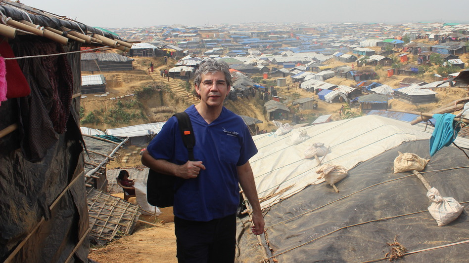 Trauma surgeon David Nott, shown above in Bangladesh, has volunteered in war zones and disaster areas around the world. Now he's treating COVID-19 patients in London. (David Nott Foundation)