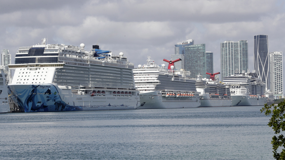 Cruise ships are docked at PortMiami on Tuesday. The U.S. Coast Guard has been working with cruise companies to bring people off of ships stricken with the coronavirus — but a new bulletin also says foreign-flagged ships should not rely on U.S. help. (Wilfredo Lee/AP)
