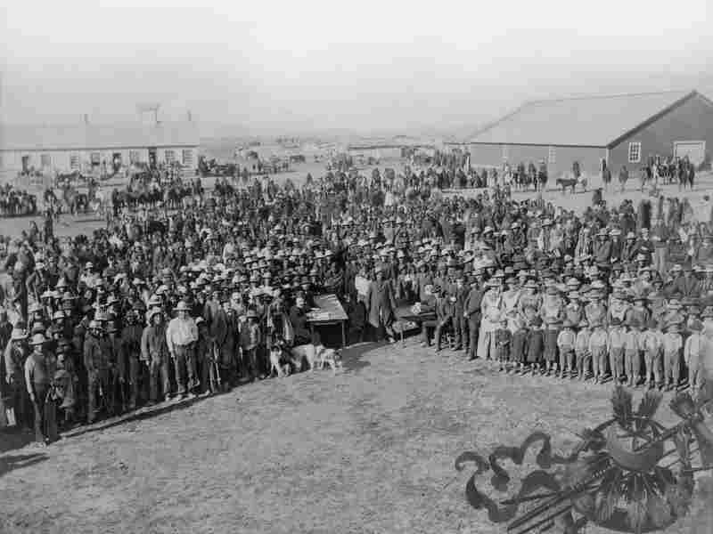 A crowd of people waiting to take the census at the Standing Rock Agency in 1886.
