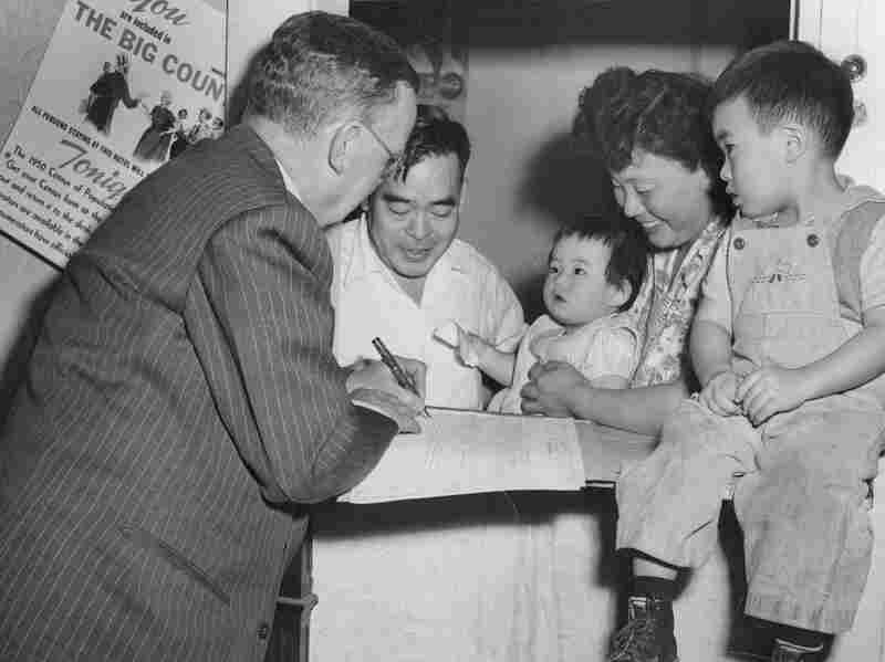 A census bureau enumerator interviewing a family in Denver, CO, 1950.