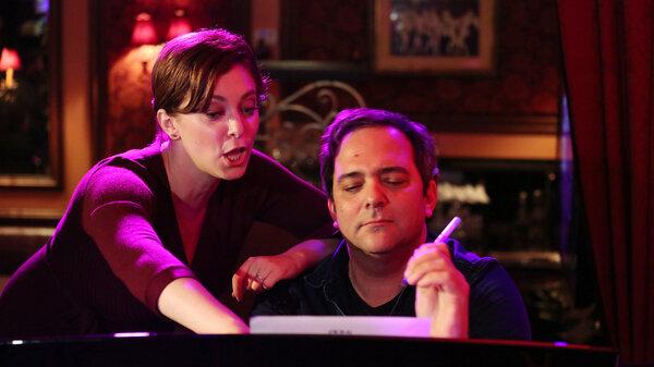 Rachel Bloom and Adam Schlesinger perform together in New York City in 2016.