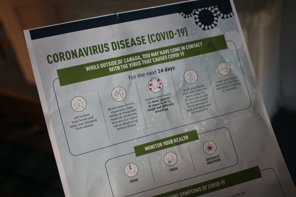 Canadian border agents are handing people entering the country a sheet from the Public Health Agency of Canada that instructs everyone to self-isolate for 14 days and monitor themselves for any symptoms that might signal a COVID-19 infection.