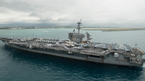 Aircraft carrier USS Theodore Roosevelt (CVN 71) arrives in Pearl Harbor, Hawaii, April 27, 2018. The Roosevelt, currently docked in Guam, has reported dozens of cases of novel coronavirus infection aboard.