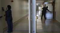 Janitors clean in a hallway in Wheeler Hall on the University of California campus in Berkeley, Calif., Wednesday, March 11, 2020. (AP Photo/Jeff Chiu)