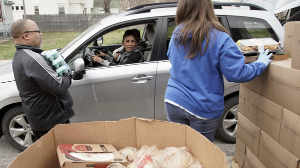 Together Inc. food bank workers distribute food at a drive-through location in Omaha, Neb., last week. Disruptions in the agricultural supply chain caused by the coronavirus pandemic are making it difficult for food banks.
