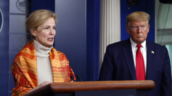 President Trump listens as Dr. Deborah Birx, White House coronavirus response coordinator, speaks about the pandemic on Friday.