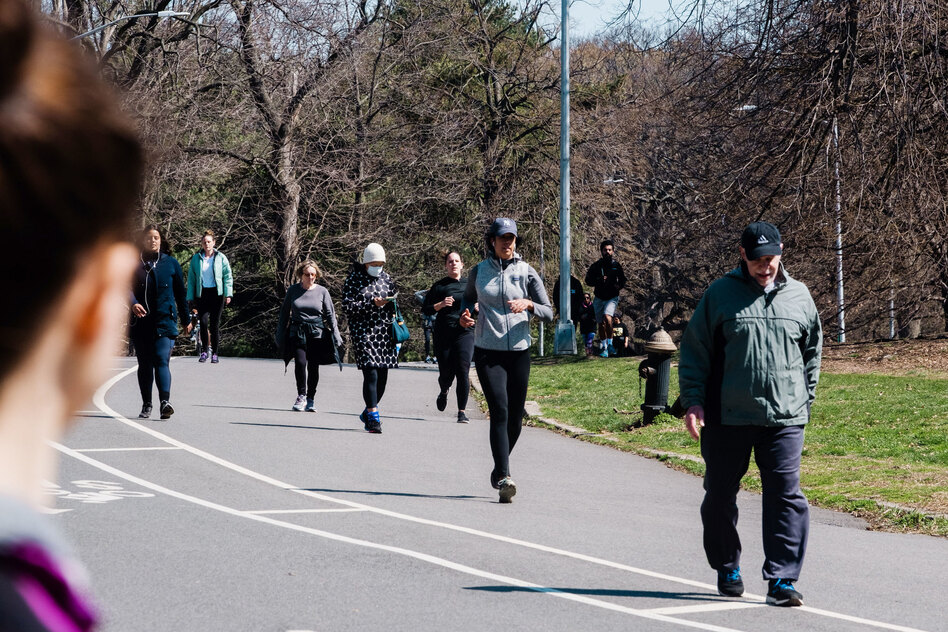 People walk and jog through Prospect Park in Brooklyn last week. New York Gov. Andrew Cuomo said that the restrictions on daily life in New York have slowed the increase in hospitalizations. (Gabriela Bhaskar/Bloomberg via Getty Images)