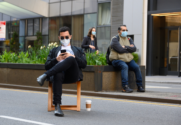 New Yorkers on Manhattan's Park Avenue cover their faces last week.