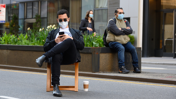 New Yorkers on Park Avenue cover their faces. The photo was taken on March 27.