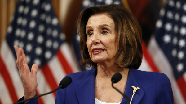 Speaker Nancy Pelosi speaks before she signs the Coronavirus Aid, Relief, and Economic Security (CARES) Act after it passed the House on March 27.
