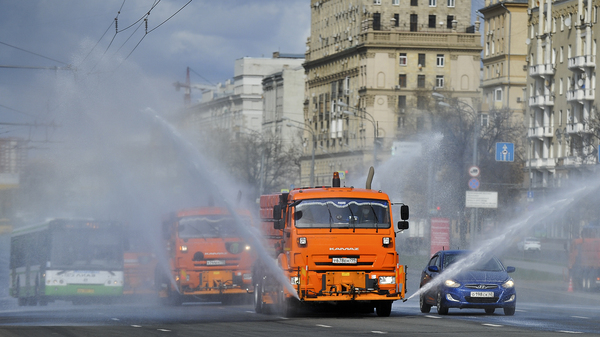 Municipal tankers spray disinfectant as a precaution against the coronavirus in Moscow on Sunday. Most of Russia
