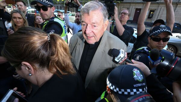 Cardinal George Pell makes his way through members of the media outside the court in Melbourne in February 2019. Australia