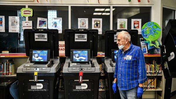 An election worker at a poling station in Miami during last month