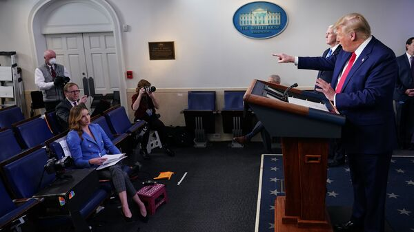 President Trump points to CNN journalist John Acosta during Monday