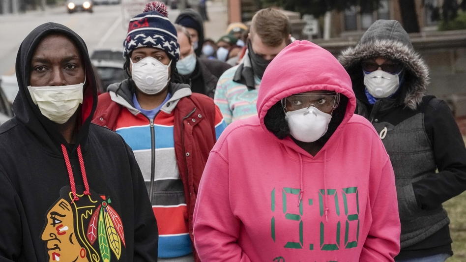 Voters masked to protect from the coronavirus line up at Riverside High School in Milwaukee. Voting went forward in the state, despite the ongoing pandemic. (Morry Gash/AP)