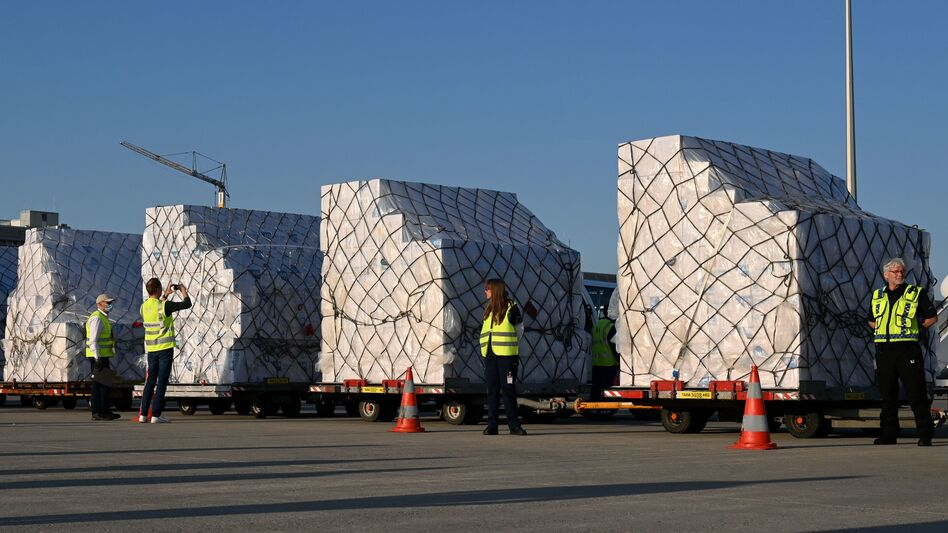Batches of 8 million protective masks are unloaded from a Lufthansa airplane at the Franz Josef Strauss airport in Munich on Tuesday after arriving from Shanghai. (Christof Stache/AFP via Getty Images)