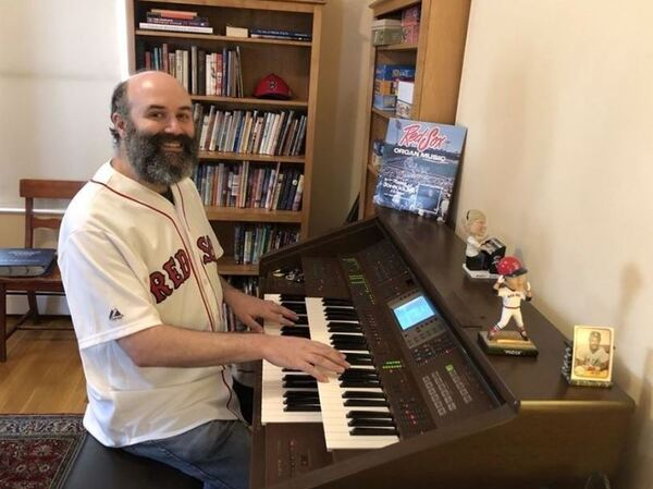 With baseball season on hold, Fenway Park organist Josh Kantor streams a show from his home each afternoon. He uses his encyclopedic knowledge of music to play requests, and he urges donations to local food banks.
