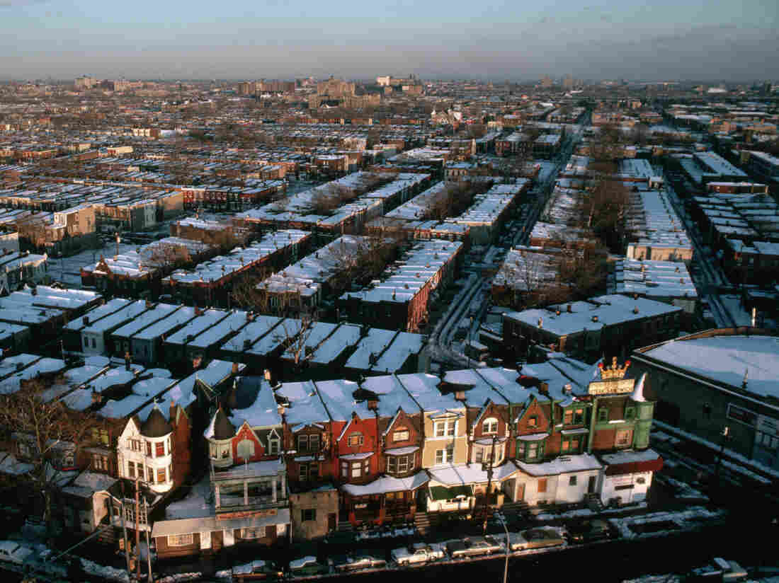 A dusting of snow covers block after block of row houses, which stand behind the restaurant which originated the Philly Cheese Steak Sandwich. (Photo by © Ted Spiegel/CORBIS/Corbis via Getty Images)