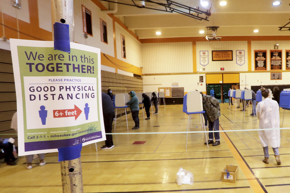 Voters cast ballots at Riverside High School during Wisconsin's primary election on Tuesday in Milwaukee. It's the only state to hold a major election since stay-at-home orders were issued across most of the country. (Morry Gash/AP)