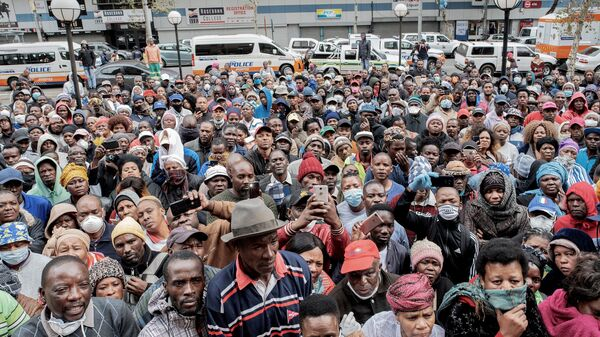 Informal vendors gather on Wednesday in front of a municipal office building in Johannesburg to try to obtain a permit for working amid the national lockdown due to the coronavirus outbreak.