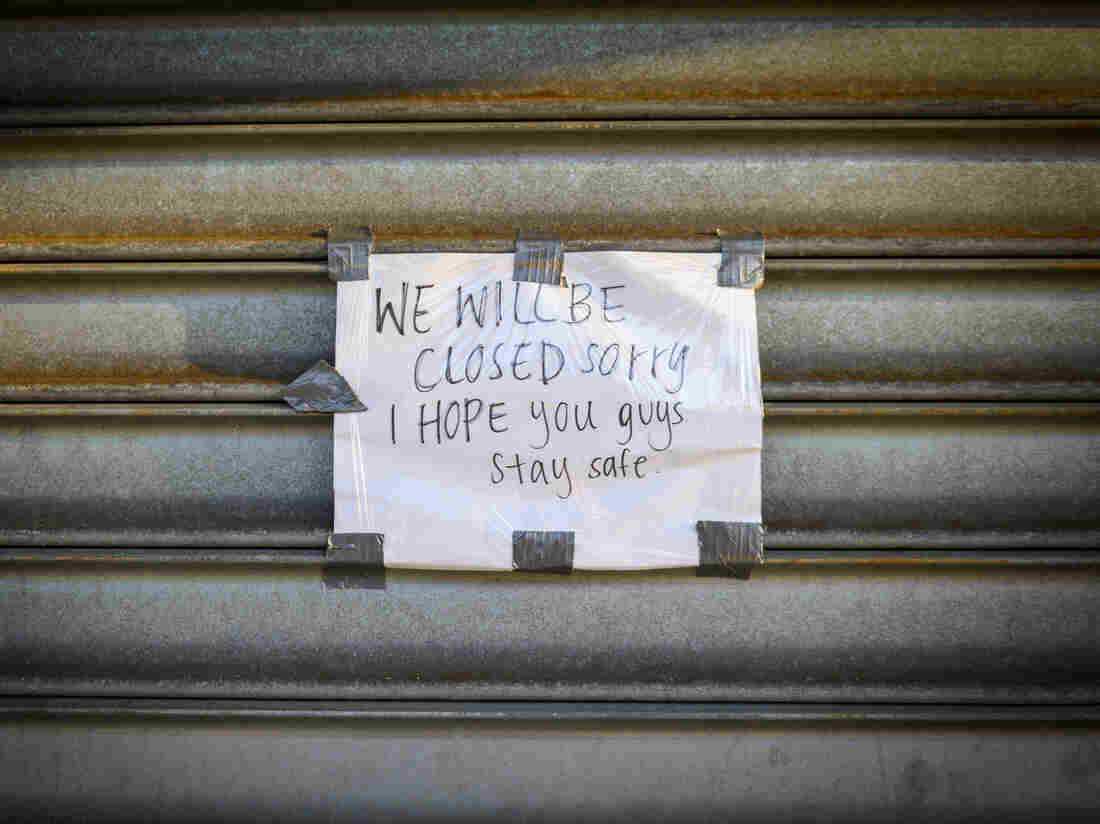 """A sign reads """"We Will Be Closed. Sorry. I Hope you guys stay safe"""" outside a store on Metropolitan Avenue in the Queens borough of New York, U.S., on Tuesday, April 7, 2020. Photographer: Christopher Occhicone/Bloomberg via Getty Images"""