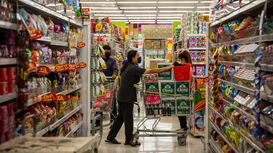 A Thai woman wearing a face mask purchases cases of beer on Thursday, the night before a citywide alcohol ban in Bangkok. Thai authorities have banned alcohol sales for 11 days in an attempt to stop social gatherings and slow the spread of COVID-19. (Lauren DeCicca/Getty Images)