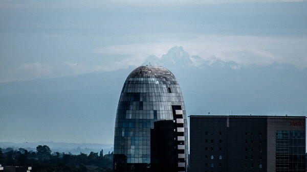 A photo taken last month by Nairobi resident Osman Siddiqi shows One Africa Place, a bullet-shaped glass high-rise in Nairobi, framed by the jagged, snowcapped peaks of Mount Kenya, which many residents said they have never seen from the capital city.