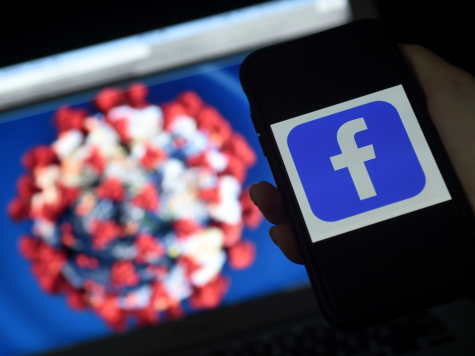 "Facebook says it has removed ""hundreds of thousands"" of pieces of misinformation about COVID-19, including dangerous fake cures and posts contradicting public health advice. (Olivier Douliery/AFP via Getty Images)"