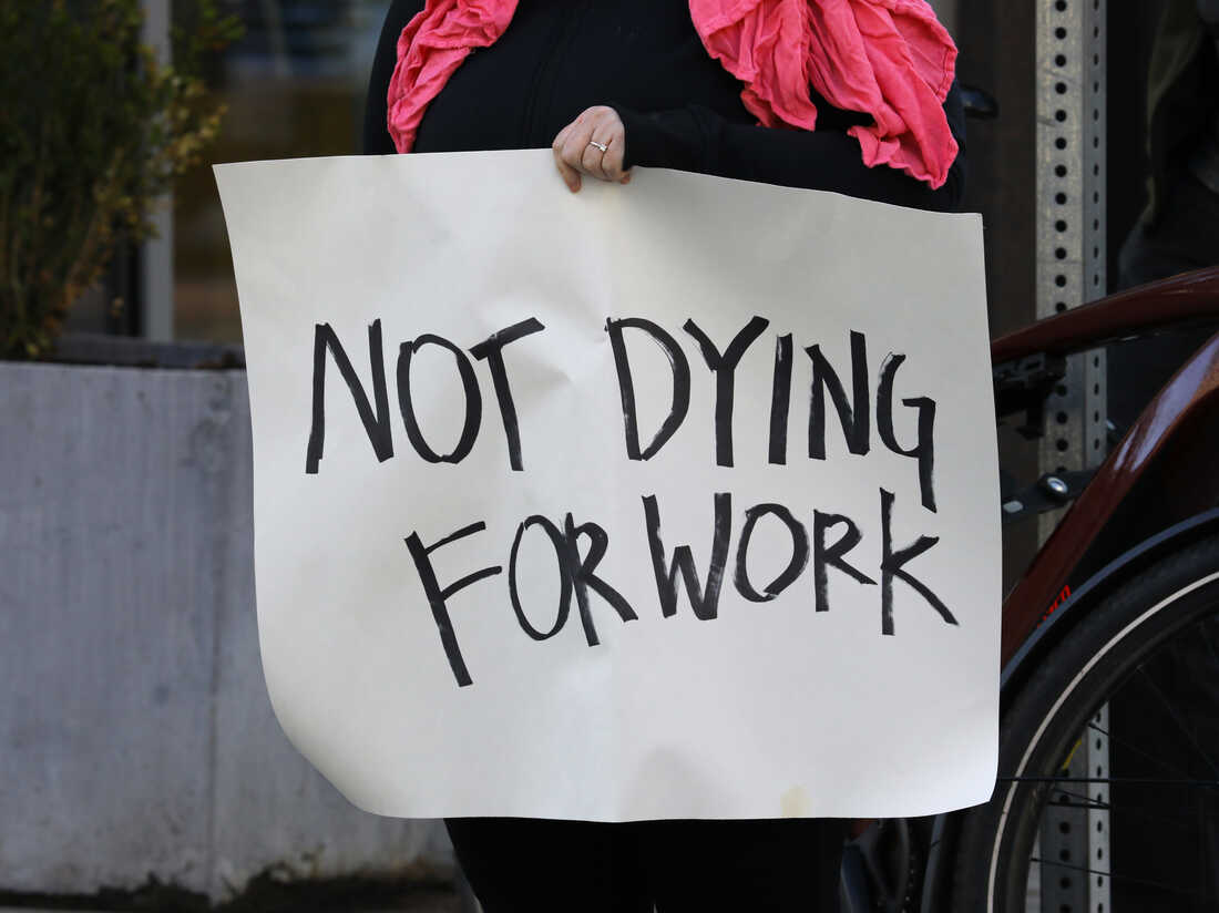 BOSTON, MA - APRIL 7: Grocery store workers and others stage a protest rally outside the Whole Foods Market to demand personal protective equipment, added benefits, and hazard pay, during the coronavirus pandemic. (Photo by Pat Greenhouse/The Boston Globe via Getty Images)