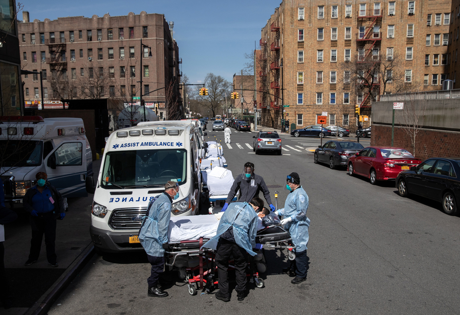 Paramedics and hospital workers prepare to lift a COVID-19 patient onto a hospital stretcher outside the Montefiore Medical Center Moses Campus, the Bronx, Tuesday, April 07, 2020, New York City. (John Moore/Getty Images)