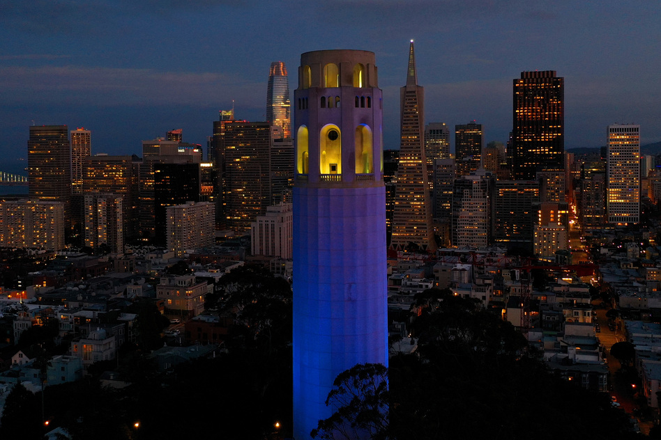 San Francisco's Coit Tower was lit up blue on April 9 as part of a nationwide tribute to health care workers and first responders on the front lines of the COVID-19 pandemic. (Justin Sullivan/Getty Images)