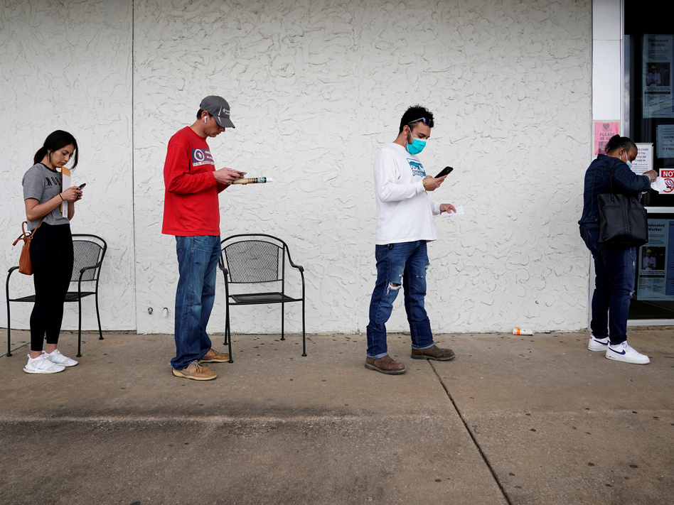 People who lost their jobs wait in line to file for unemployment benefits at an Arkansas Workforce Center in Fayetteville, Ark., on April 6. (Nick Oxford/Reuters)