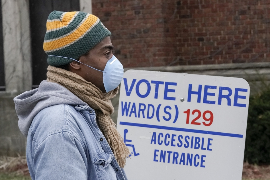 A voter in line in Milwaukee during this month's Wisconsin election. Voting took place after multiple lawsuits to change absentee ballot deadlines, a possible preview of legal battles to come in 2020. (Morry Gash/AP)