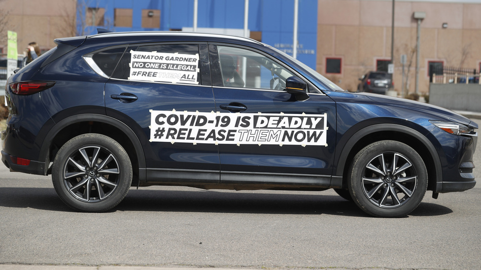 A sign on a vehicle during a protest outside an ICE detention center in Colorado. Immigration lawyers are calling for the release of detainees as the coronavirus spreads at ICE facilities around the country. (David Zalubowski/AP)