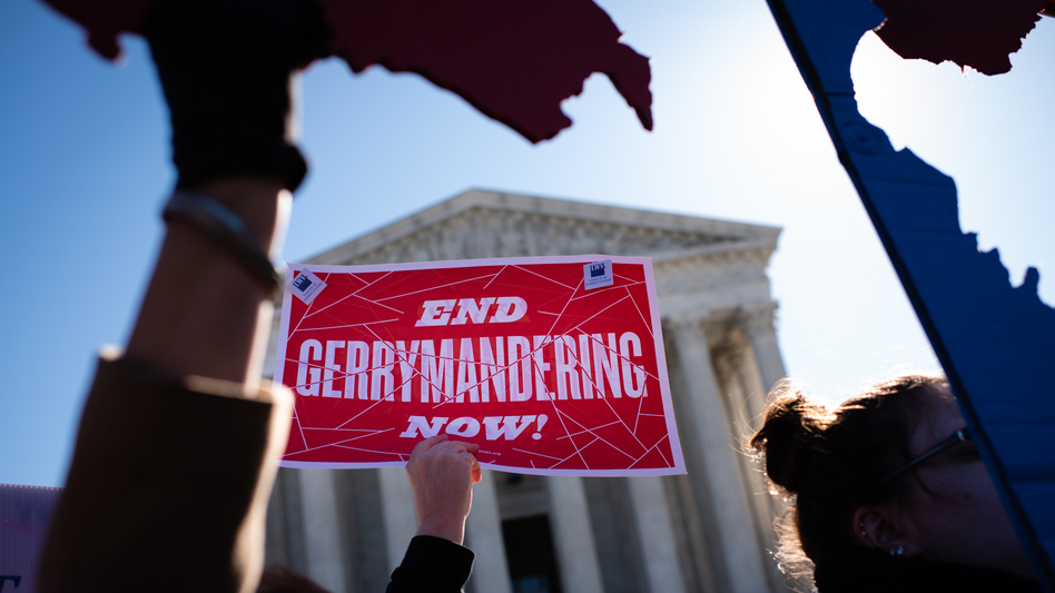 An activist holds a sign outside the U.S. Supreme Court in 2019. (Sarah L. Voisin/The Washington Post via Getty Images)