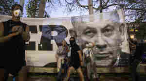 Israel's Netanyahu Wins Bid To Remain As Prime Minister In Deal With Election Rival