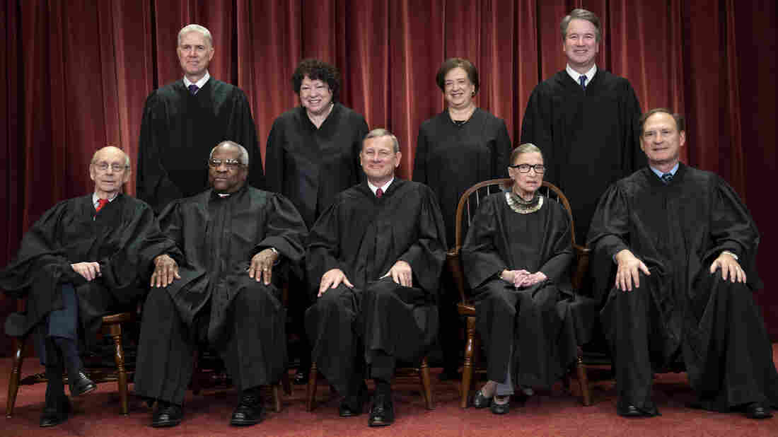 The justices of the U.S. Supreme Court: seated from left: Stephen Breyer, Clarence Thomas, Chief Justice John G. Roberts, Ruth Bader Ginsburg and Samuel Alito Jr. Standing behind from left: Neil Gorsuch, Sonia Sotomayor, Elena Kagan and Brett M. Kavanaugh.