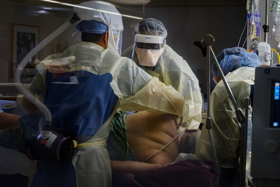 Nurses reposition an intubated COVID-19 patient in a prone position in the intensive care unit at Sharp Chula Vista Medical Center, Chula Vista, Calif., on April 10. (Marcus Yam/Los Angeles Times via Getty Images)